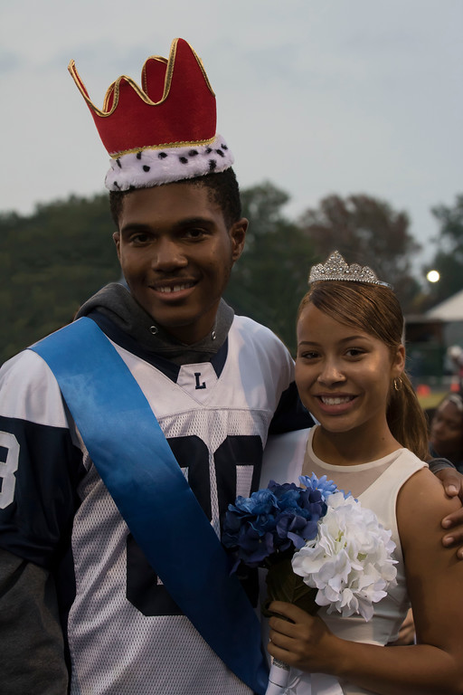 . Jen Forbus - The Morning Journal<br> Lorain Homecoming King Ke\'andre Davis and Queen Angelika Patterson were announced prior to the Titans\' game against Warrensville Heights on Oct. 6.