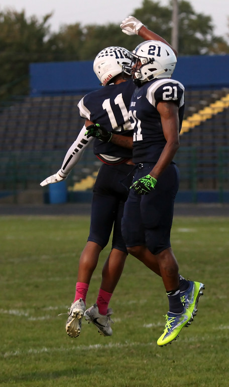. Randy Meyers - The Morning Journal<br> Daylin Dower and Zion Cross celebrate after the Titans score a first quarter touchdown and two-point conversion against Clarkson Academy on Sept. 22.