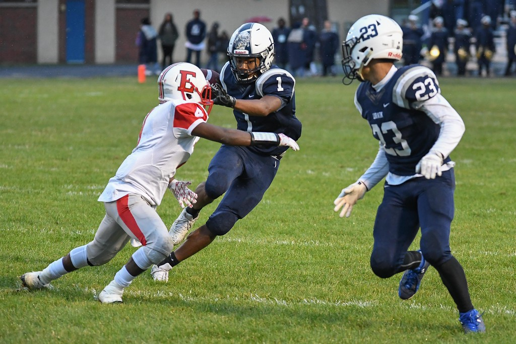 . Eric Bonzar�The Morning Journal<br> Lorain Titans wide receiver Tyshawn Lighty (1) jukes his way past Elyria\'s Keshaun Glover (4), Sept. 7, 2017.