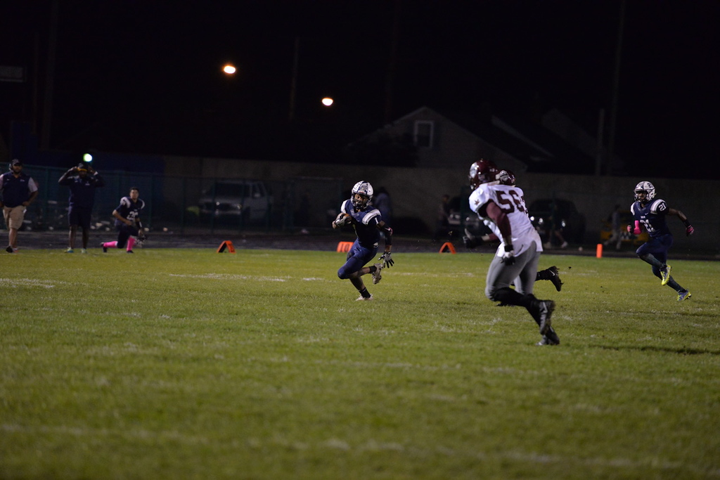 . Aimee Bielozer - The Morning Journal<br> Lorain\'s Tyshawn Lighty runs back an interception against Maple Heights on Oct. 13.