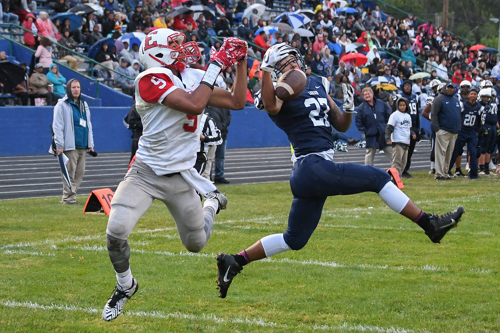 . Eric Bonzar�The Morning Journal<br> Lorain\'s Dakota Mincy (27) intercepts a catch intended for Elyria\'s Qwanda Woodson (5), Sept. 7, 2017.