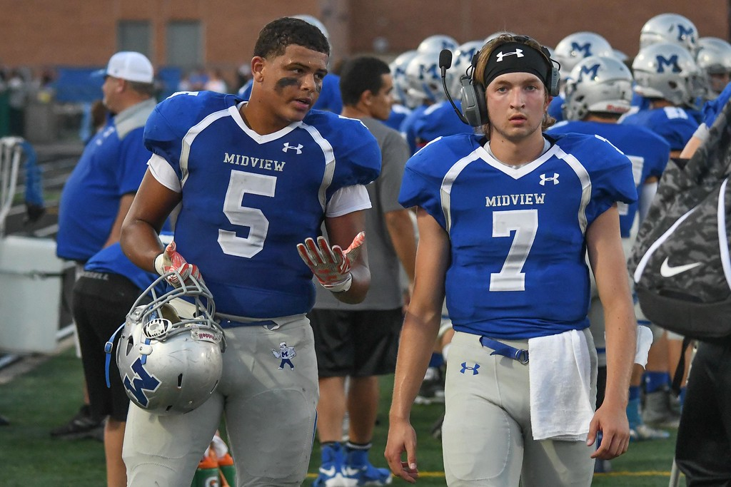 . Eric Bonzar�The Morning Journal<br> Midview wide receiver Alonzo Banks (5) confers with quarterback Seamus Higley (7) on the sideline after the pair connected for a touchdown, Sept. 15, 2017.