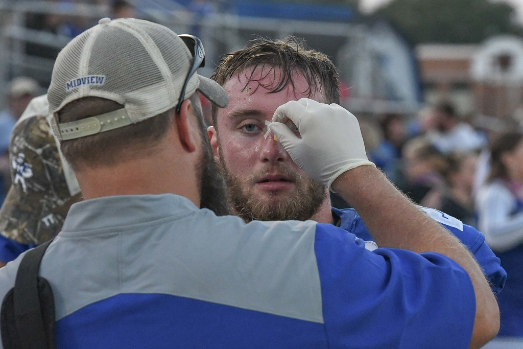 . Eric Bonzar�The Morning Journal<br> Midview running back Connor Wolfe gets the bridge of his nose taped up after getting it busted open in the first quarter, Sept. 15, 2017.