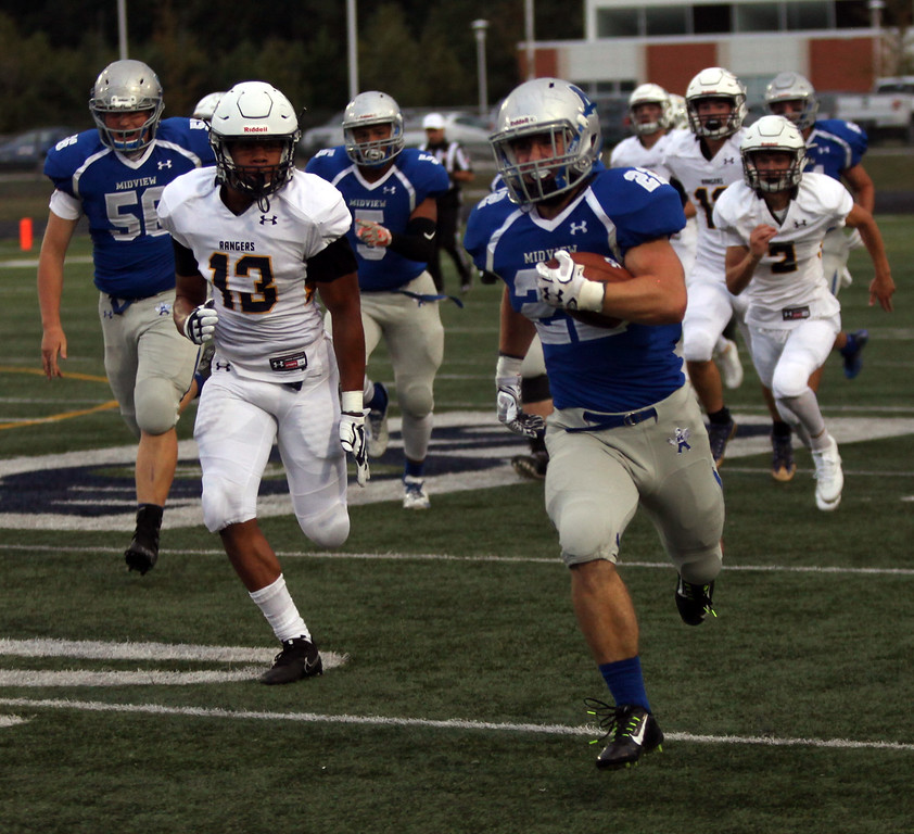 . Randy Meyers - The Morning Journal<br> Midview senior running back Connor Wolfe runs through the North Ridgeville defense for a big gain during the second quarter on Sept. 1.