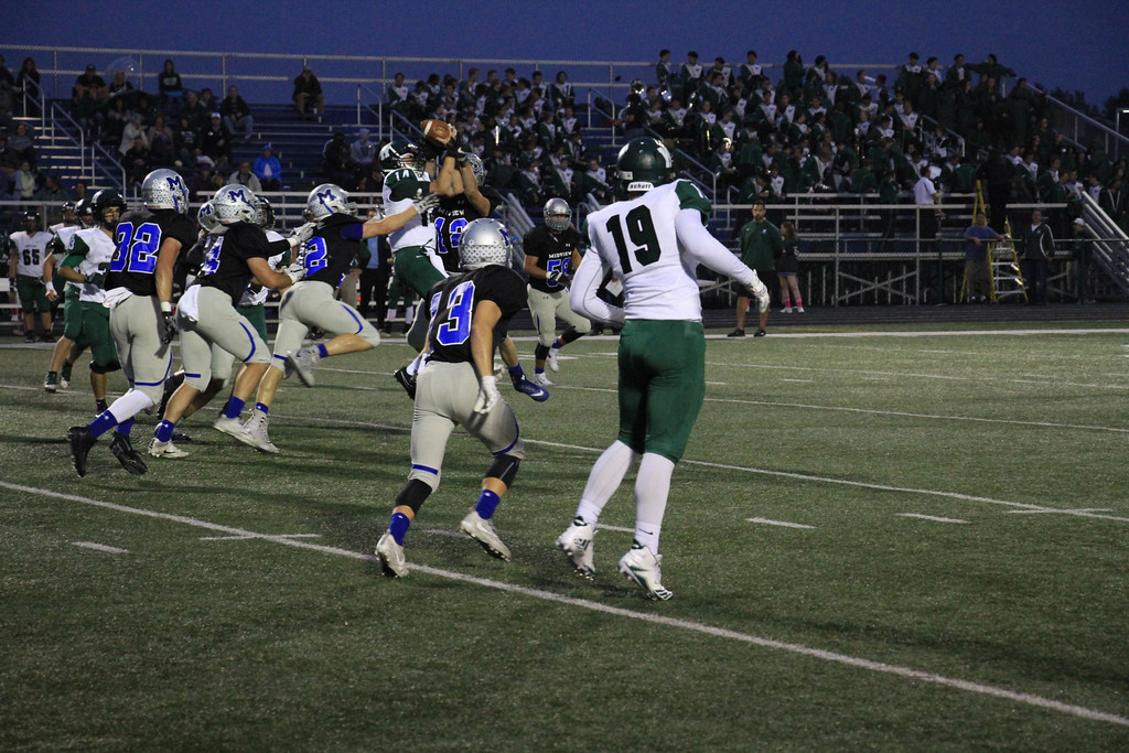 . Nicholas Pfeifer - The Morning Journal<br> A Westlake pass batted at the line of scrimmage is intercepted by the Midview defense on Oct. 6