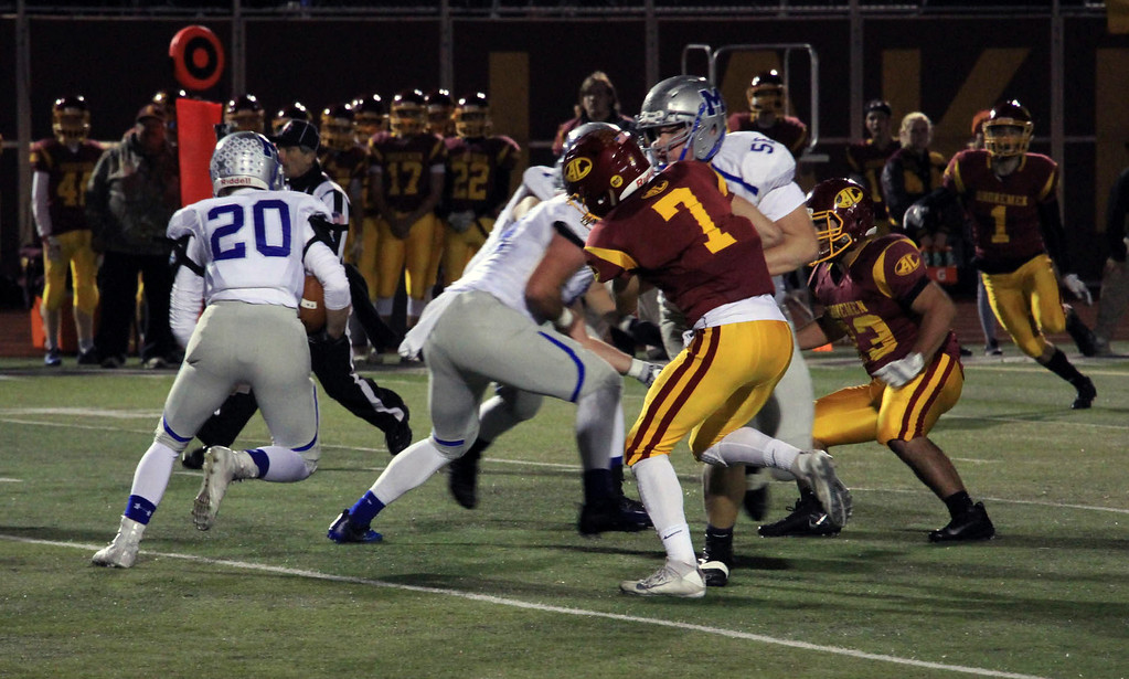 . Nicholas Pfeifer - The Morning Journal<br> Midview\'s Seth Sanders take a hand off on first down against Avon Lake on Oct. 27.