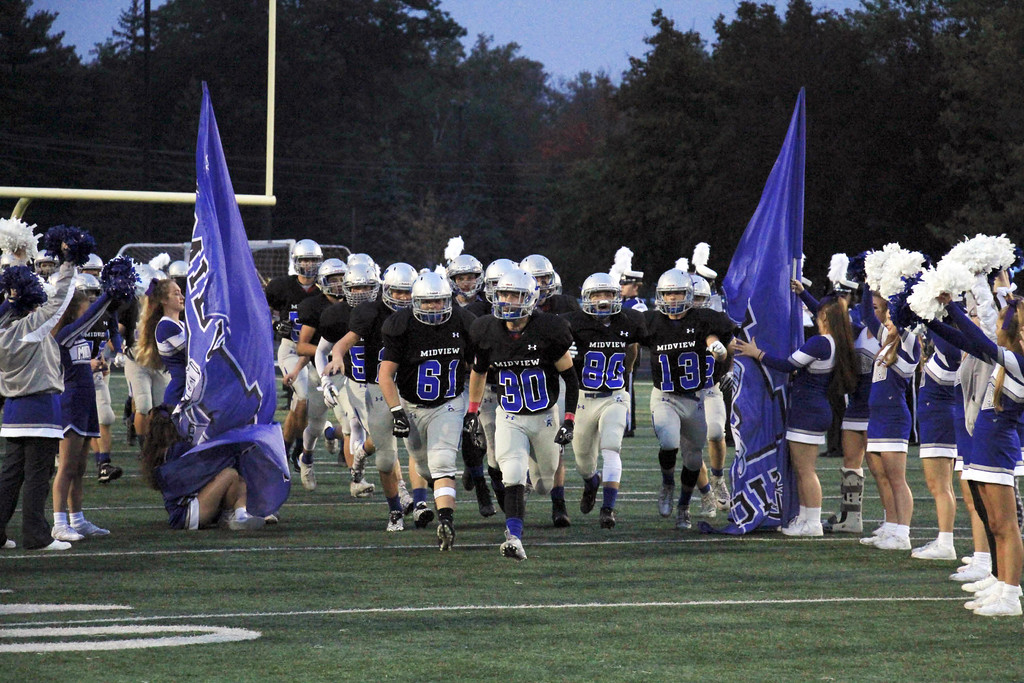 . Nicholas Pfeifer - The Morning Journal<br> The Midview Middies take the field against the visiting Westlake Demons on Oct. 6.