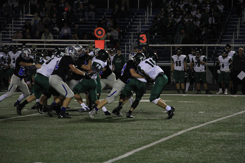 . Nicholas Pfeifer - The Morning Journal<br> Midview\'s Trever Begin bursts through the line on third and short for a huge defensive stop against Westlake on Oct. 6.
