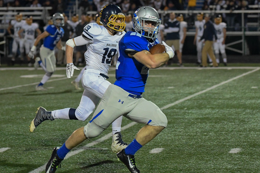 . Eric Bonzar�The Morning Journal<br> Midview running back Connor Wolfe (22) eyes up a defender as he breaks for a 51 yard touchdown, Oct. 13, 2017.