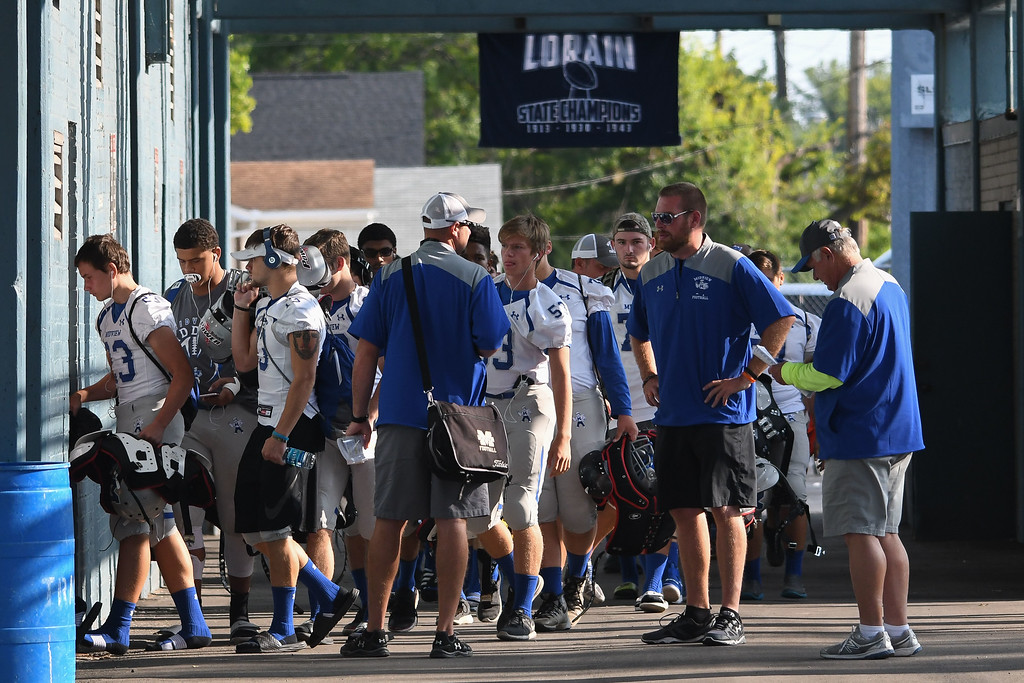 . Eric Bonzar�The Morning Journal<br> The Midview Middies traveled to Lorain, where they kicked off their 2017 season against the Titans, Aug. 25, 2017.