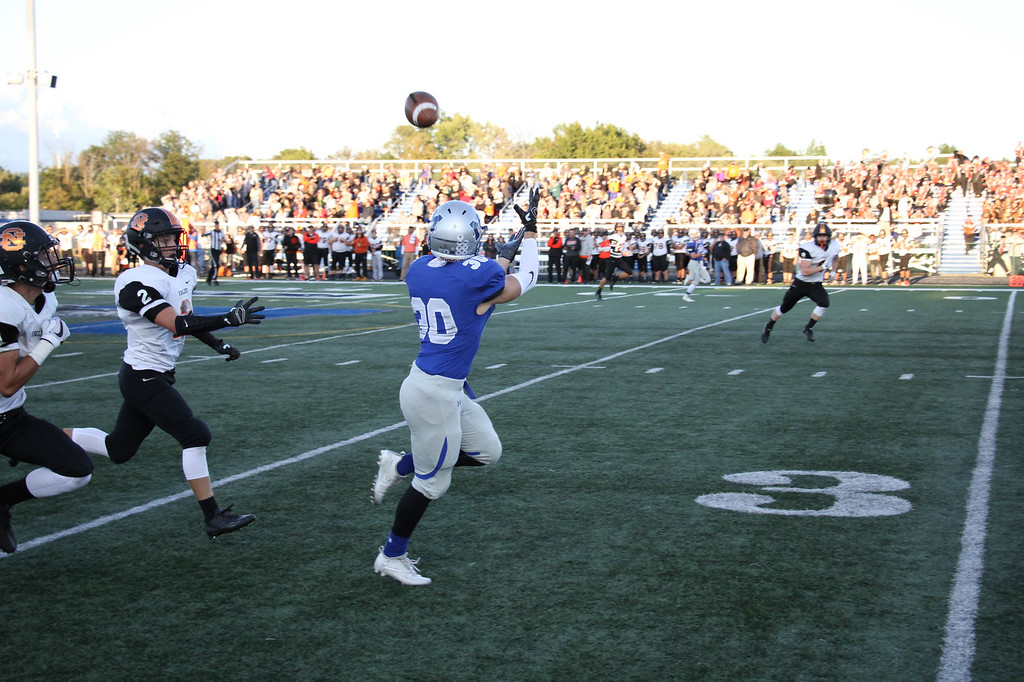 . Nicholas Pfeifer - The Morning Journal<br> Midview\'s Ben Gendics hauls in a long touchdown pass from Seamus Higley against North Olmsted on Sept. 8.