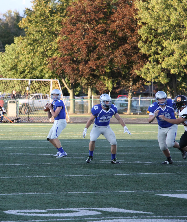 . Nicholas Pfeifer - The Morning Journal<br> Midview\'s Seamus Higley sits comfortably in the pocket and delivers a deep strike for a touchdown against North Olmsted on Sept. 8.