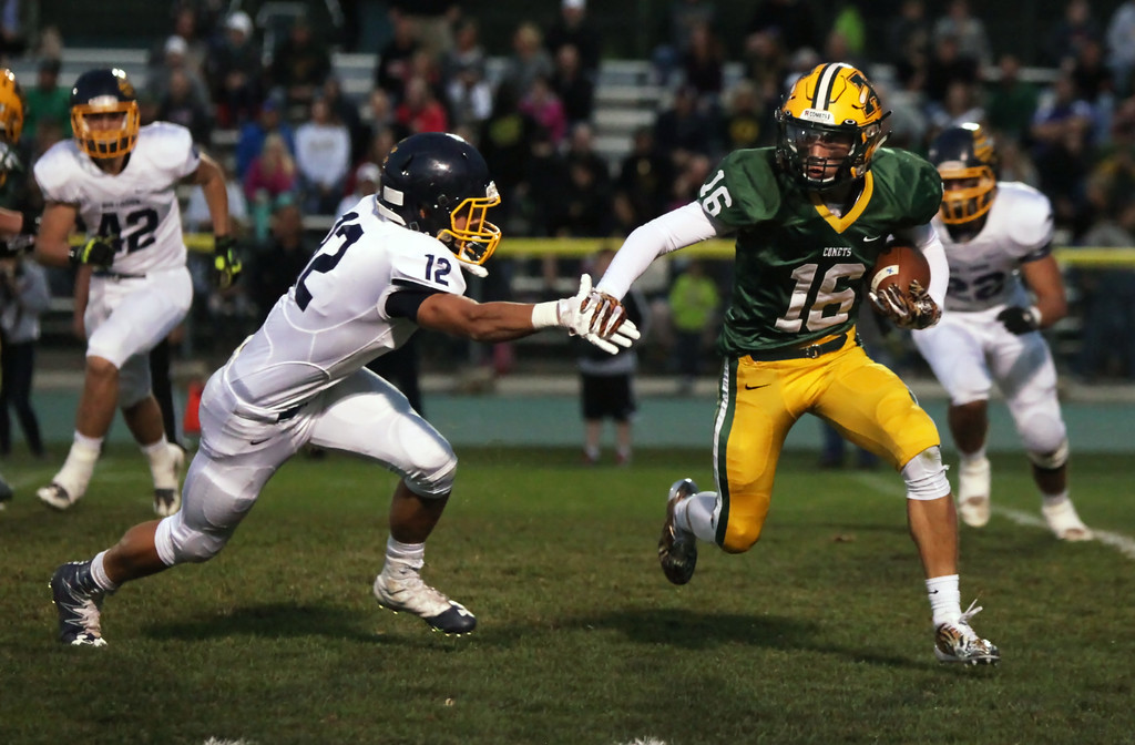. Randy Meyers - The Morning Journal<br> Evan Shawver of Amherst runs left and tries to avoid the tackle by Michael Dulin of Olmsted Falls during the second quarter on Sept. 29.