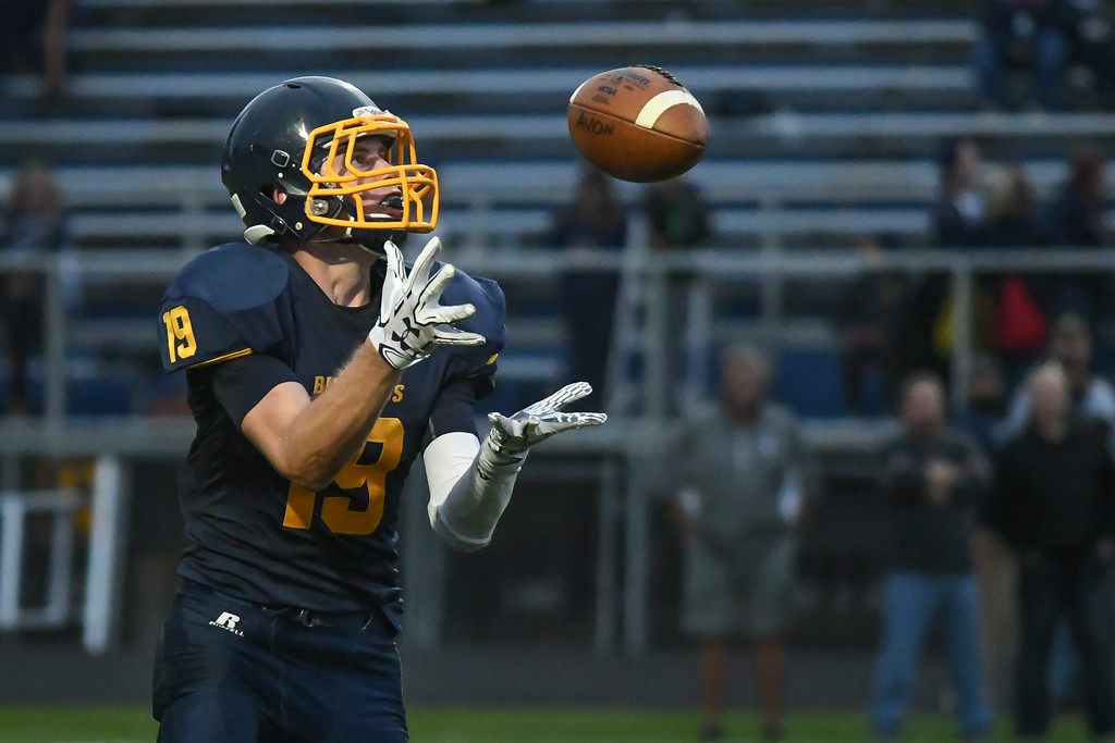 . Eric Bonzar�The Morning Journal<br> Olmsted Falls\' Braden Galaska (19) fields a punt, Sept. 1, 2017.
