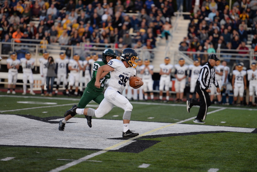 . Aimee Bielozer - The Morning Journal<br> Olmsted Falls\' runnnig back Jack Spellacy races away from Westlake\'s JJ Coleman for a touchdown on Sept. 8.
