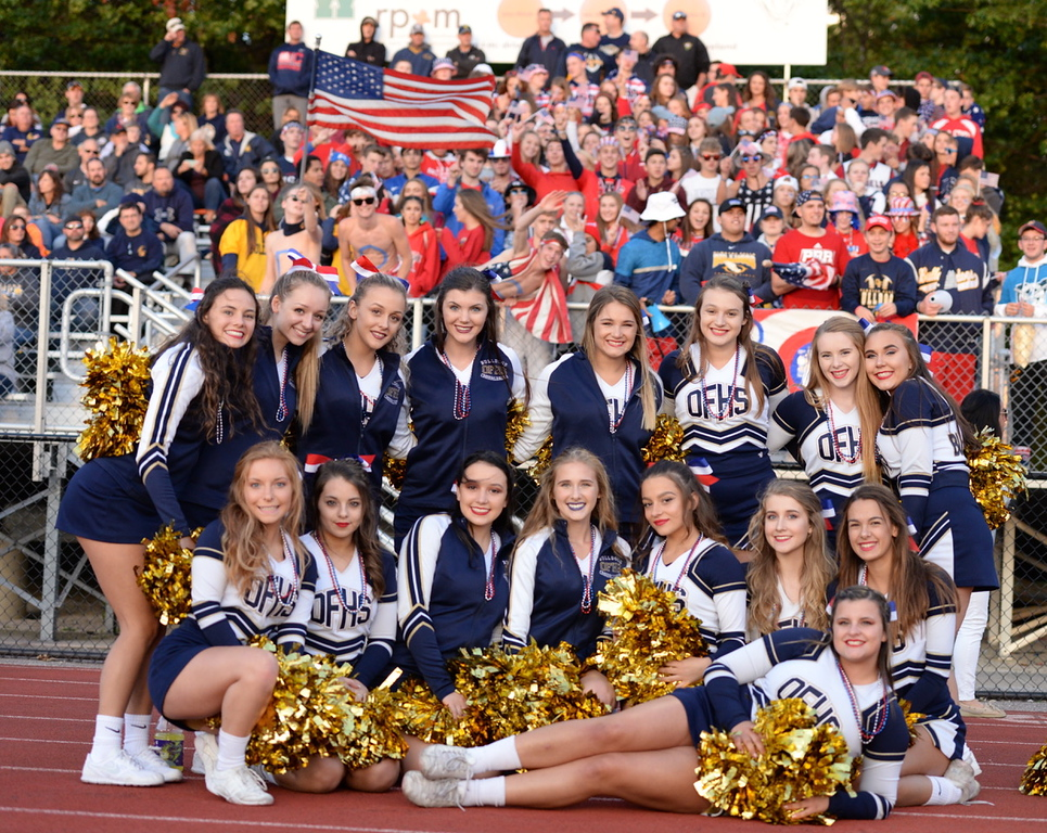 . Aimee Bielozer - The Morning Journal<br> The Olmsted Falls cheerleaders pose in front of the student section on Sept. 8.
