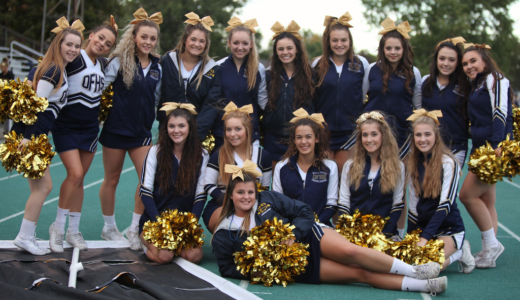 . Randy Meyers - The Morning Journal<br> Olmsted Falls cheerleaders pose for a photo prior to Friday\'s game against Amherst.