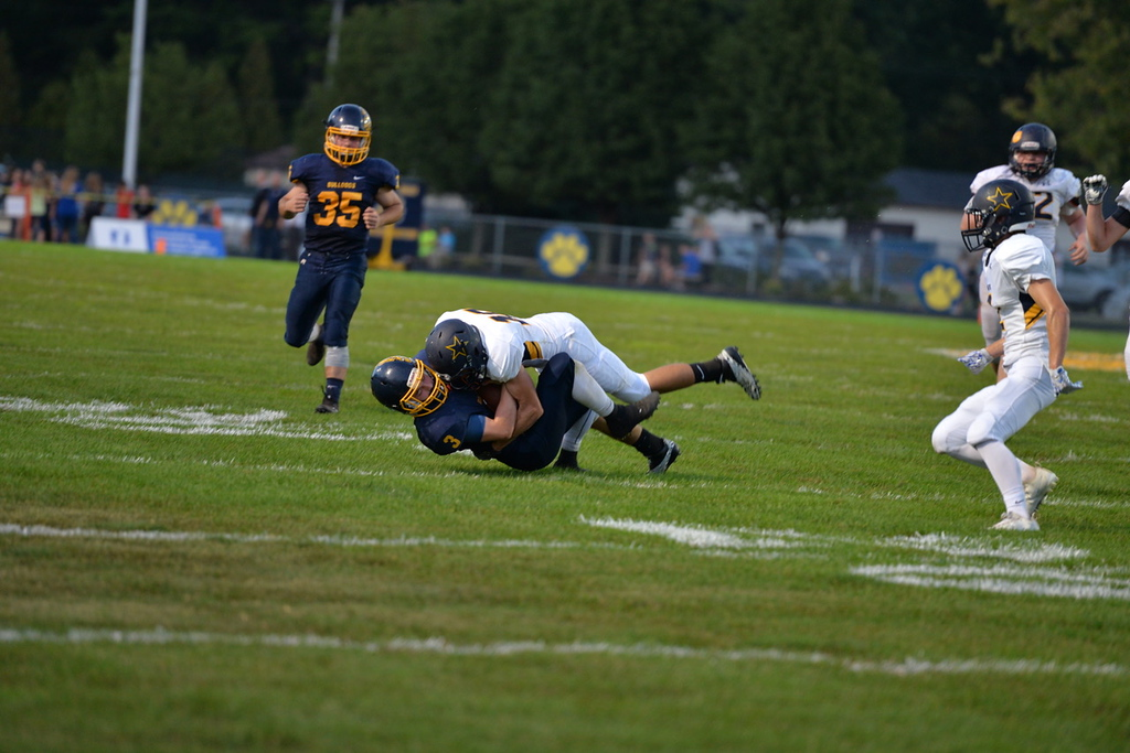 . Aimee Bielozer - The Morning Journal<br> North Ridgeville\'s Jarod Dennis tackles Olmsted Falls\' Nick Daily on Sept. 22.