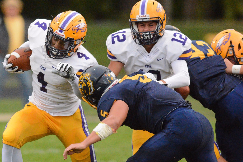 . Eric Bonzar - The Morning Journal<br> Avon\'s Tony Eberhardt looks to turn the corner against Olmsted Falls on Sept. 1.