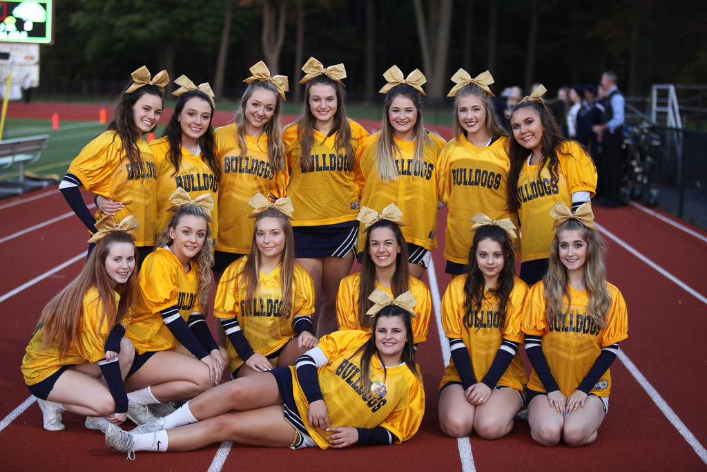 . Randy Meyers - The Morning Journal<br> The Olmsted Falls varsity cheerleaders pose for a photo prior to Friday\'s game against Avon Lake.