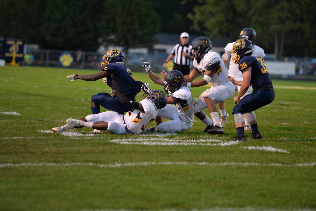 . Aimee Bielozer - The Morning Journal<br> The Bulldogs\' Michael Howard get taken down by North Ridgeville defenders on Sept. 22.