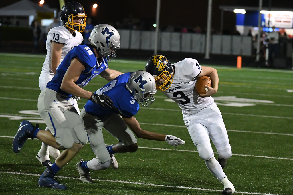 . Eric Bonzar�The Morning Journal<br> Olmsted Falls\' Nick Daily (3) crashes helmet to helmet with Midview defender Aidan Breggins (3), Oct. 13, 2017.