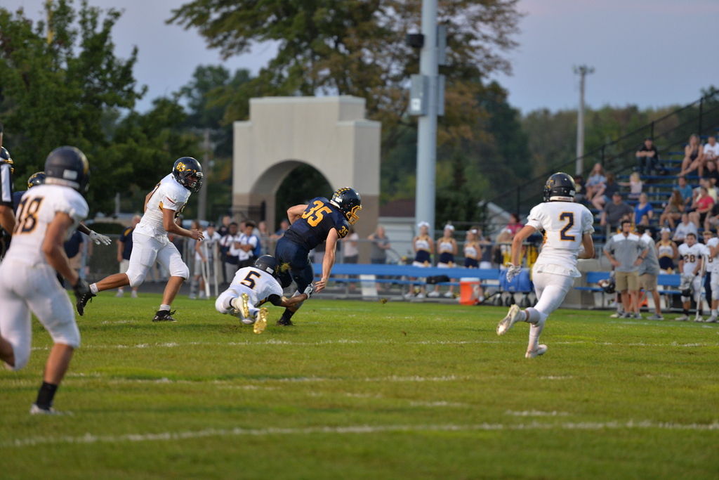 . Aimee Bielozer - The Morning Journal<br> The Bulldogs\' Jack Spellacy get away from North Ridgeville\'s Tyler Richmond on Sept. 22.
