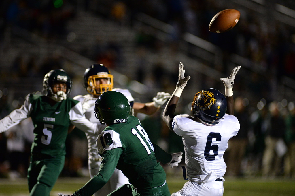 . Aimee Bielozer - The Morning Journal<br> Olmsted Falls\' Michael Howard intercepts a pass on the goaline intended for Westlake\'s Anthony Kettel on Sept. 8.