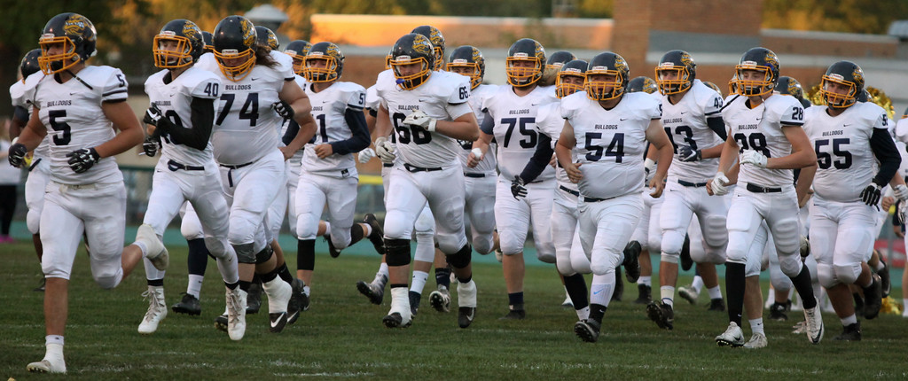 . Randy Meyers - The Morning Journal<br> The Olmsted Falls Bulldogs take the field against the Amherst Comets on Friday night.