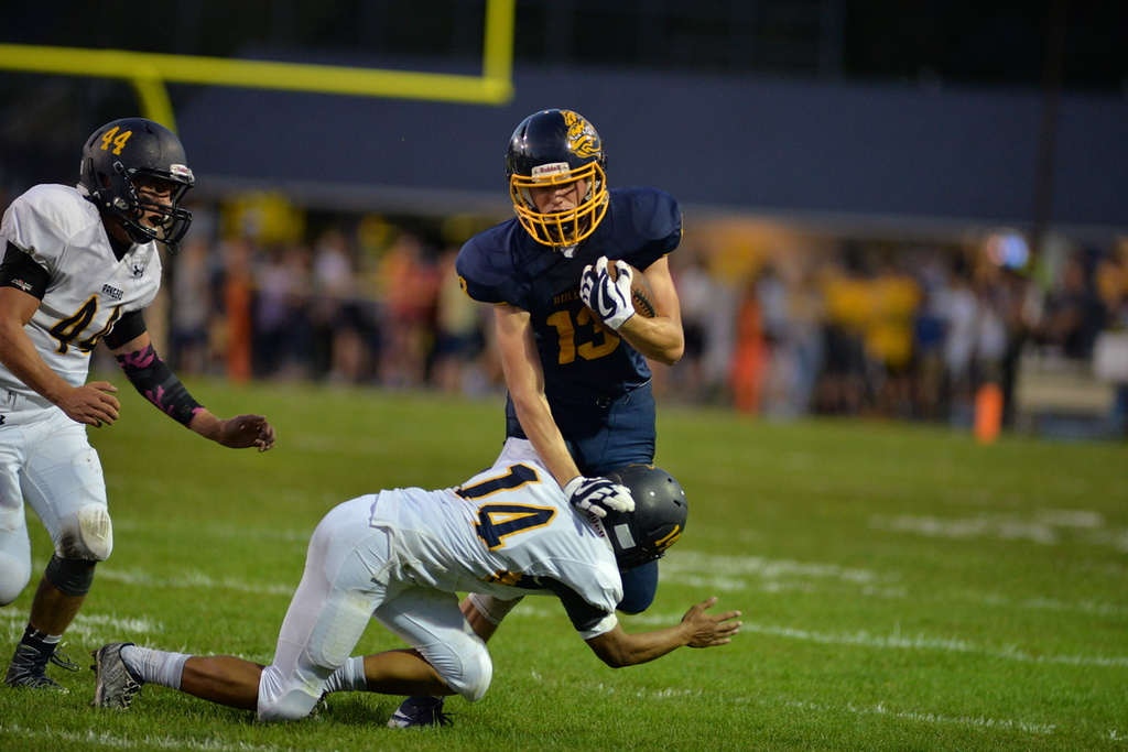 . Aimee Bielozer - The Morning Journal<br> Olmsted Falls\' Richie Nock gets tripped up by North Ridgeville\'s Marcus McLean on Sept. 22.