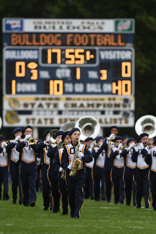 . Eric Bonzar�The Morning Journal<br> The Olmsted Falls band takes the field before the Bulldogs\' Southwestern Conference match-up against the Avon Eagles, Sept. 1, 2017.