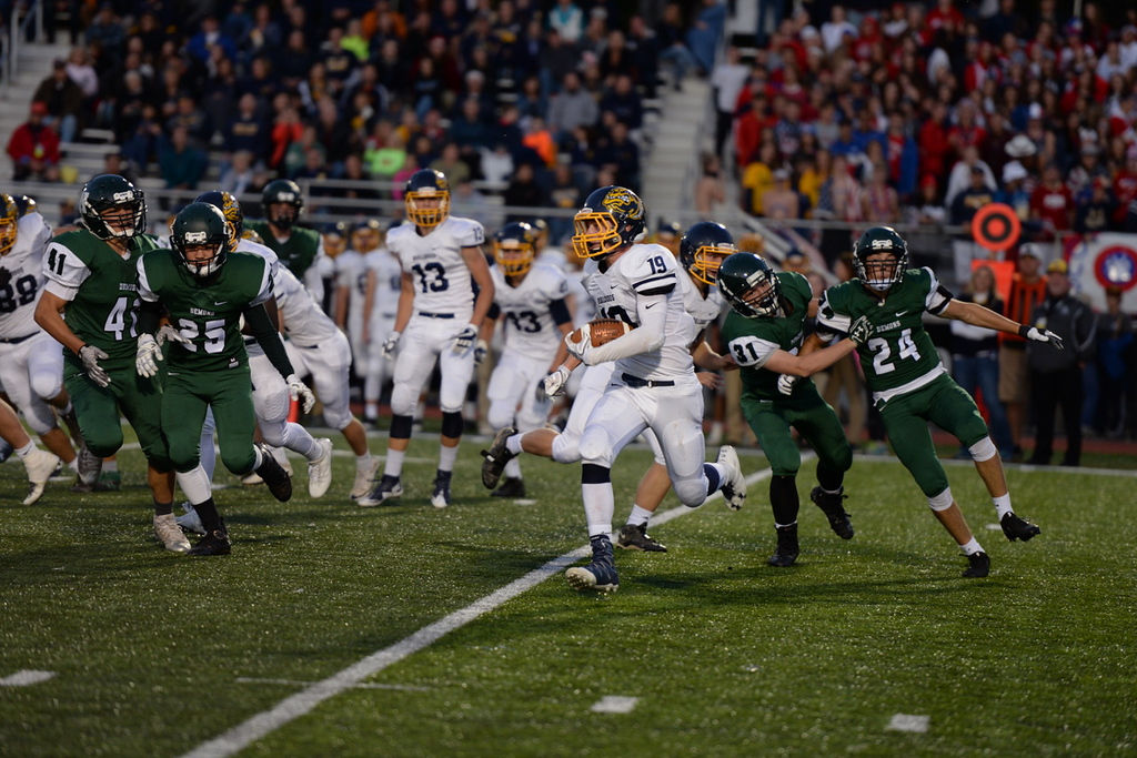 . Aimee Bielozer - The Morning Journal<br> Olmsted Falls\' Braden Galaska turns the corner around the Westlake defense on Sept. 8.