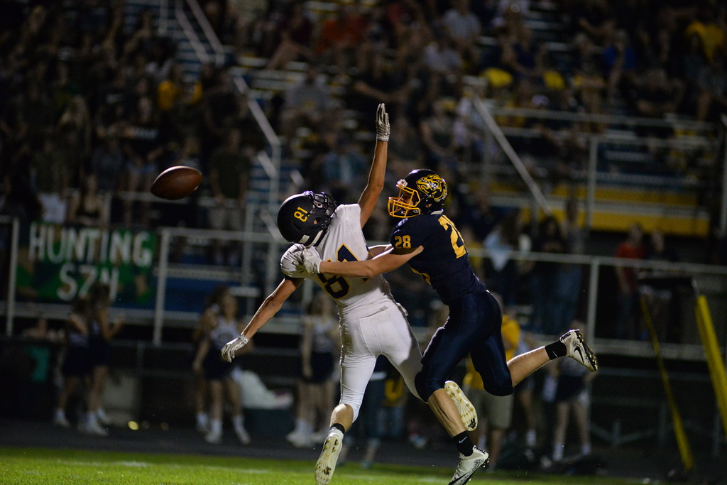. Aimee Bielozer - The Morning Journal<br> North Ridgeville\'s Austin Casey tries to make a play on a high pass against Olmsted Falls on Sept. 22.