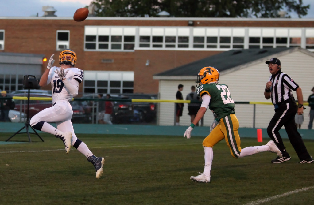 . Randy Meyers - The Morning Journal<br> Braden Galaska of Olmsted Falls beats Hunter Parker of Amherst for a first quarter touchdown reception on Sept. 29.