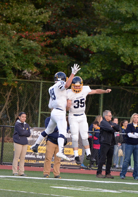 . Aimee Bielozer - The Morning Journal<br> Olmsted Falls Jack Spellacy and Braeden Galaska celebrate a touchdown against Westlake on Sept. 8.