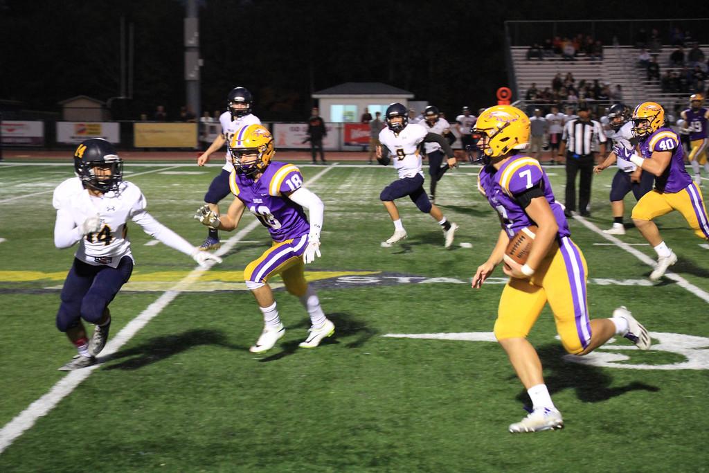 . Nicholas Pfeifer - The Morning Journal<br> Avon quarterback Carson Gosselin runs the ball against North Ridgeville on Oct. 13.
