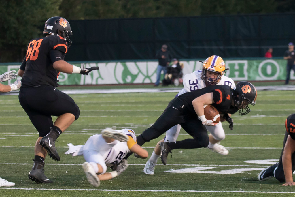 . Jen Forbus - The Morning Journal<br> Avon\'s Aaron Endrizal and Mark Steinmetz work to bring down North Olmsted wide receiver Owen Juhn on Sept. 15.