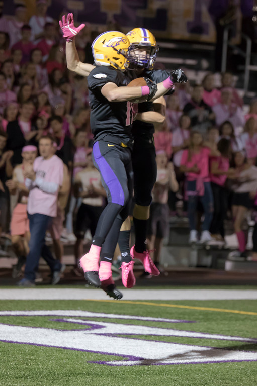 . Jen Forbus - The Morning Journal<br> Avon\'s Matt Kennedy celebrates with Chris Mullins following Mullins\' first quarter touchdown against Amherst on Oct. 20.