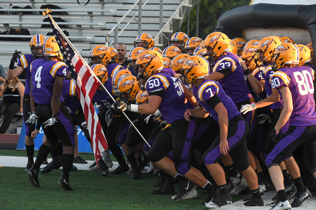 . Eric Bonzar�The Morning Journal<br> The Avon Eagles take the field for their Southwestern Conference home game against the Midview Middies, Sept. 22, 2017.