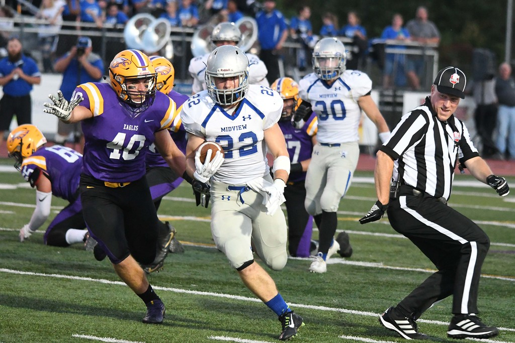 . Eric Bonzar�The Morning Journal<br> Midview running back Connor Wolfe (22) finds a hole in the Avon Eagle defense, Sept. 22, 2017.