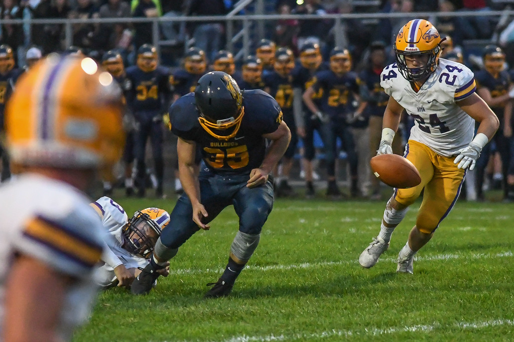 . Eric Bonzar�The Morning Journal<br> Olmsted Falls\' Jack Spellacy (35) fumbles the football, Sept. 1, 2017.