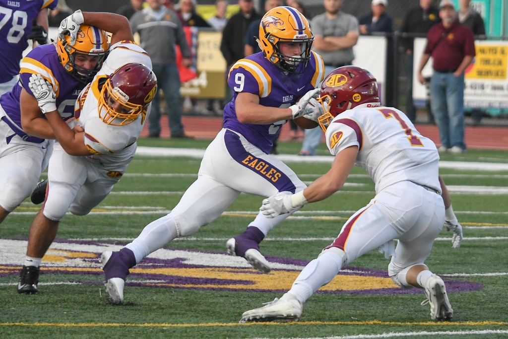 . Eric Bonzar�The Morning Journal<br> Avon receiver David Orlando (9) stiff arms his way past Avon Lake safety Andrew Butrey (7), Sept. 8, 2017.