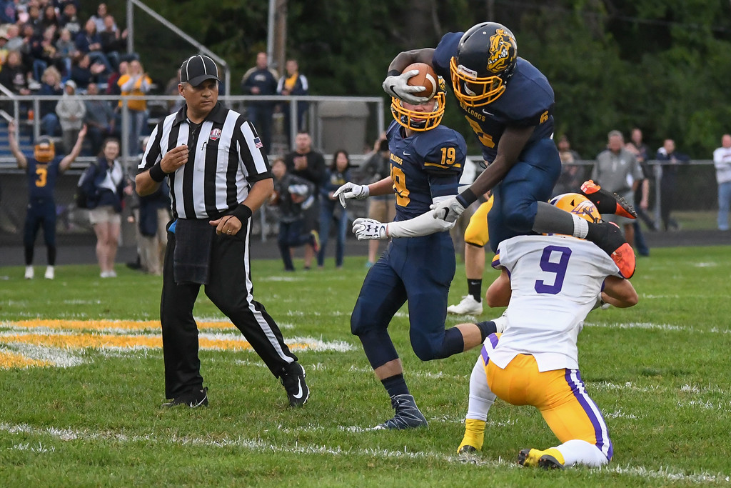 . Eric Bonzar�The Morning Journal<br> Olmsted Falls\' Michael Howard (6) is upended by Avon\'s David Orlando (9) as he returns a kick off in the first quarter, Sept. 1, 2017.
