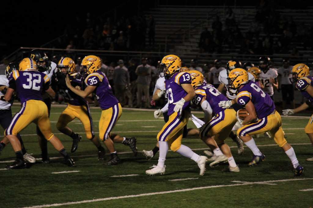 . Nicholas Pfeifer - The Morning Journal<br> Avon\'s David Orlando follows a flock of Eagles on the sideline on a kick return to give the Eagles great starting field position against North Olmsted on Oct. 13.