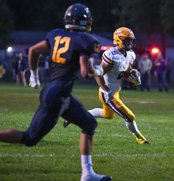 . Eric Bonzar�The Morning Journal<br> Avon\'s David Orlando (9) makes his way in to the end zone for 6 points, in the second quarter, Sept. 1, 2017.