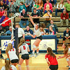 Anton Albert - The News-Herald<br /> Mentor's  Marissa Peoples hits the ball during Mentor's regional semifinal against Jackson on Nov. 3. Also pictured are Mentor's  Alexa Cundy (5), Ashleigh Barton (17), Rachel Barton (2), Maddie Morrison (4) and Alexis Garrett (15) and Jackson's  Alexandra Spencer (2) and Cameron Dinger (24).