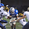 Jon Behm - The Morning Journal<br /> Midview's Brandon Gilchrist (46) slams his way thought he Olmsted Falls defense as the Bulldogs' Josh Jaeckin (4) and Connor Lara (34) try and stop him on Nov. 4.