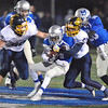 Jon Behm - The Morning Journal<br /> Midview's Isiah Johnson is wrapped up by Olmsted Falls' Tyler Neely (27) and John McCabe during the fourth quarter on Nov. 4.
