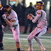 Jon Behm - The Morning Journal<br /> Avon Lake's Mark Pappas searches for an open receiver during the second quarter against Avon on Nov. 4.