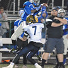 Jon Behm - The Morning Journal<br /> Midview's Keith Johnson rises up for a catch over the defense of Olmsted Falls' Josh Goodwin during the fourth quarter on Nov. 4.